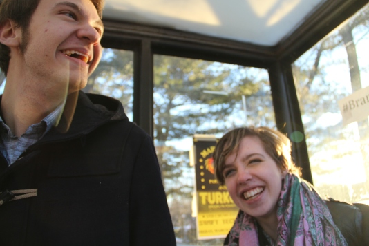 Andrew and Emily laugh as they wait for the shuttle.