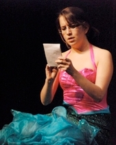 Lydia performs as a mermaid.